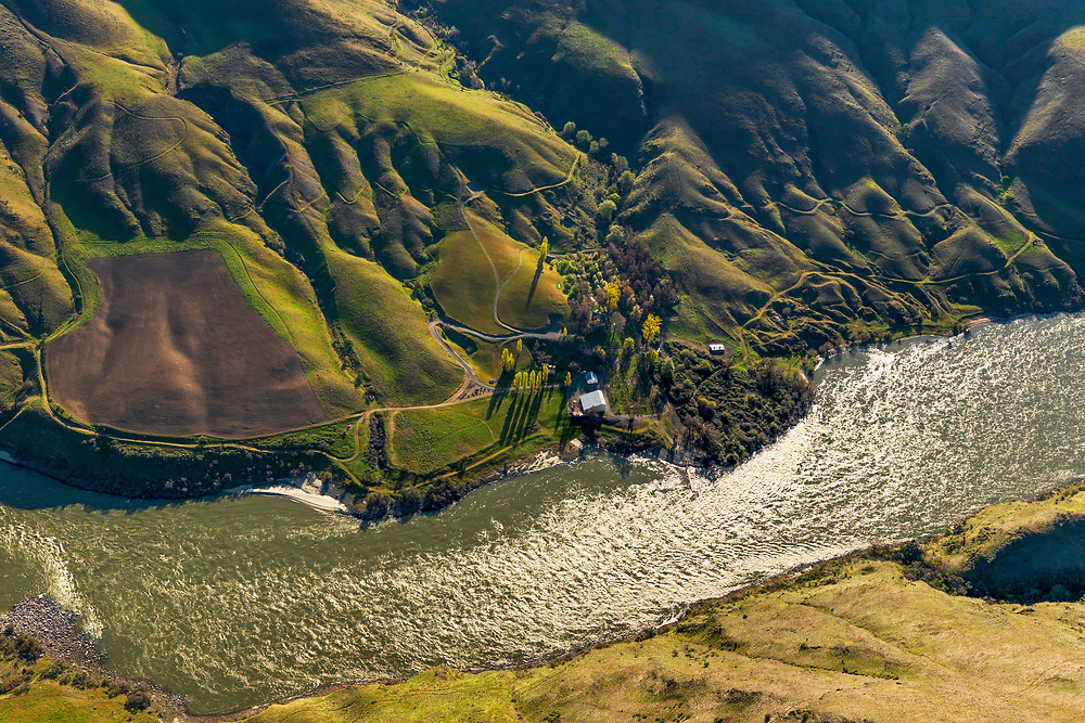 Aerial of River accessable only Garden Creeek Ranch owned by the Nature Conservany on the Snake River in Hells Canyon south of Lewiston Idaho with Washington State on foreground side of river.