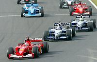14.10.2001 Suzuka, Japan,<br />Michael Schumacher im Ferrari fŸhrt nach dem Start vor Bruder Ralf Schumacher und Juan Pablo Montoya im BMW-Williams am (14.10.2001) beim Formel 1 Grand Prix von Japan in Suzuka. © Jerg/Digitalsport