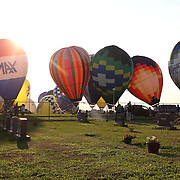 A man watches the launch from Battle Creek Memorial Park  as hot air balloons take to the skies around rural Michigan near Battle Creek during the World Hot Air Ballooning Championships. Battle Creek, Michigan, USA. 20th August 2012. Photo Tim Clayton