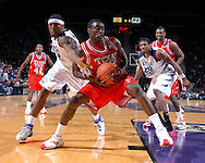 Texas Tech guard Martin Zeno (C) pulls the ball away from Kansas State's David Hoskins (L) during the first half at Bramlage Coliseum in Manhattan, Kansas, January 8, 2007.  Texas Tech defeated K-State 62-52.