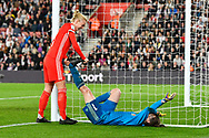 Laura O'Sullivan (1) of Wales goes down with cramp and is helped by Sophie Ingle (4) of Wales during the FIFA Women's World Cup UEFA Qualifier match between England Ladies and Wales Women at the St Mary's Stadium, Southampton, England on 6 April 2018. Picture by Graham Hunt.