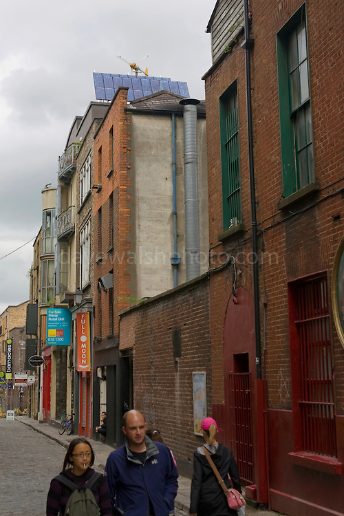 The Green Building, Temple Bar, Dublin, with wind turbines and solar panels on the roof. Build in 1994, uses lots of sustainable energy solutions. This includes using a borehole to pull heat from the ground below. ..