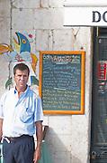 A cafe and restaurant. The waiter. Lisbon, Portugal