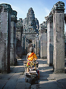 The Temple of Bayonne near Angkor was built by the ruler Jayavarman VII between 1181 and 1200 A.D.  It features stone carvings of Buddha faces on the towers of the third level and a stone Buddha sculpture here on the first.