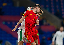 CARDIFF, WALES - Sunday, November 15, 2020: Wales' Ben Davies (L) challenges for a header with Republic of Ireland's Daryl Horgan during the UEFA Nations League Group Stage League B Group 4 match between Wales and Republic of Ireland at the Cardiff City Stadium. Wales won 1-0. (Pic by David Rawcliffe/Propaganda)