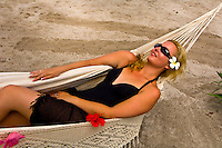 Woman on her honeymoon relaxing in a hammock, Vatulele Island Resort, Fiji Islands