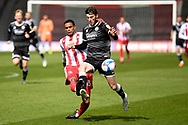 Stevenage defender Terence Vancooten (15) battles for possession  Crawley Town forward Ashley Nadeson (10) during the EFL Sky Bet League 2 match between Stevenage and Crawley Town at the Lamex Stadium, Stevenage, England on 1 May 2021.