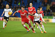 Cardiff's Sean Morrison © holds off  Tom Lawrence of Rotherham Utd (l). Skybet football league championship match, Cardiff city v Rotherham Utd at the Cardiff city stadium in Cardiff, South Wales on Saturday 6th December 2014<br /> pic by Andrew Orchard, Andrew Orchard sports photography.