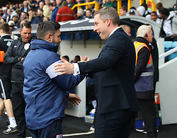 Millwall manager Neil Harris (right) and Bristol City manager Lee Johnson embrace ahead of their Sky Bet Championship football match