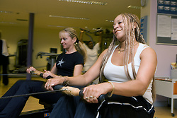 Two women using rowing machines at Southglade Leisure Centre; Nottingham