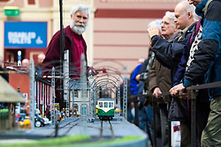 19/01/2018. London, UK. Enthusiasts watch as a model tram passes along a miniature street at the London Model Engineering Exhibition at Alexandra Palace. Over 50 clubs and societies are exhibiting nearly 2,000 models constructed by their members. Photo credit: Rob Pinney