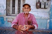 25 JULY 2002 - HAVANA, HAVANA, CUBA: Man with cigars in the Regla neighborhood of Havana, Cuba, July 25, 2002. .PHOTO BY JACK KURTZ