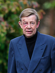 © Licensed to London News Pictures. 07/10/2014London, UK. Henry Kelly arriving for the funeral of singer Lynsey de Paul in Hendon, North London Photo credit : Simon Jacobs/LNP