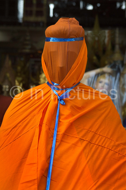 Covered religious figures ready to be transported. Situated in the heart of Bangkok, near the famous swing, is a series of streets and alleyways dedicated to the manufacture of Buddhist and Hindu icons together with other religious paraphernalia.