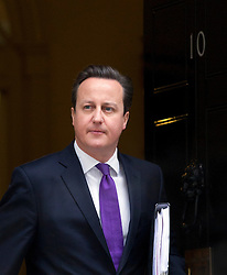 © Licensed to London News Pictures. 23/01/2013. London, UK. The British Prime Minister, David Cameron, is seen leaving Downing Street for Prime Minister's Questions in London today (23/01/13) after giving a keynote speech on Britain's future in Europe earlier in the morning. The prime minister was expected to call for the terms of Great Britain's membership of the union to be re-negotiated. Photo credit: Matt Cetti-Roberts/LNP