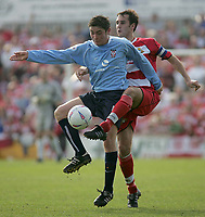 Photo. Andrew Unwin<br /> Doncaster Rovers v York, Nationwide League Division Three, Earth Stadium, Belle Vue, Doncaster 24/04/2004.<br /> York's Andy Bell (l) battles with Doncaster's Steve Foster (r).