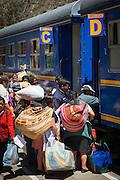 Passengers boarding the PeruRail train leading to and From Machu Picchu, Cusco Region, Urubamba Province, Machupicchu District in Peru, South America