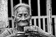 Portrait of an old wrinkled vietnamese woman selling lottery tickets in Go Dau, Tay Ninh Province, Vietnam, Southeast Asia