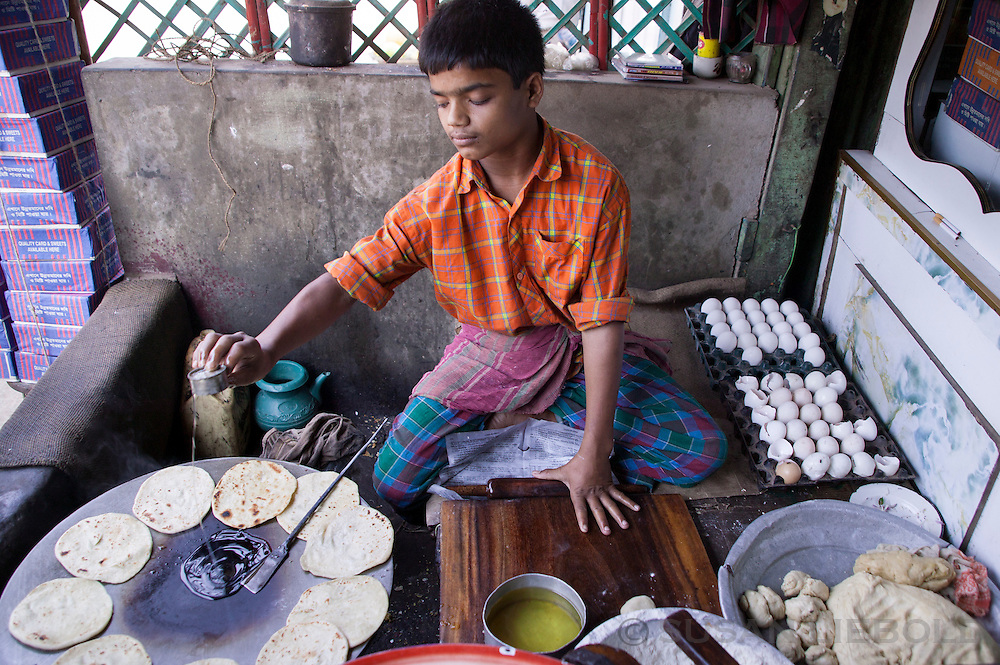 Boy making chapatis in a small local restaurant in Bangladesh.