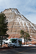 Snow melts on Checkerboard Mesa in Zion National Park, Utah, USA, visited by RV (Recreational Vehicle).