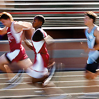 Kofa's Tevin Alford (center) attempts to pass his teammate Jordan Gullickson during a 100-meter dash Wednesday at Irv Pallack field.