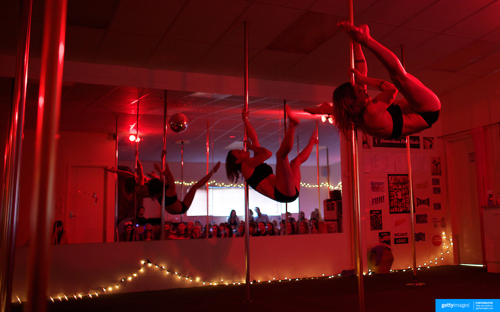 Anna Ashton, front,  pole dancing during the Queenstown Pole Studios end of year show at the Queenstown Pole Studio, Gorge Road,  Queenstown. South Island, New Zealand. 10th November, 2011