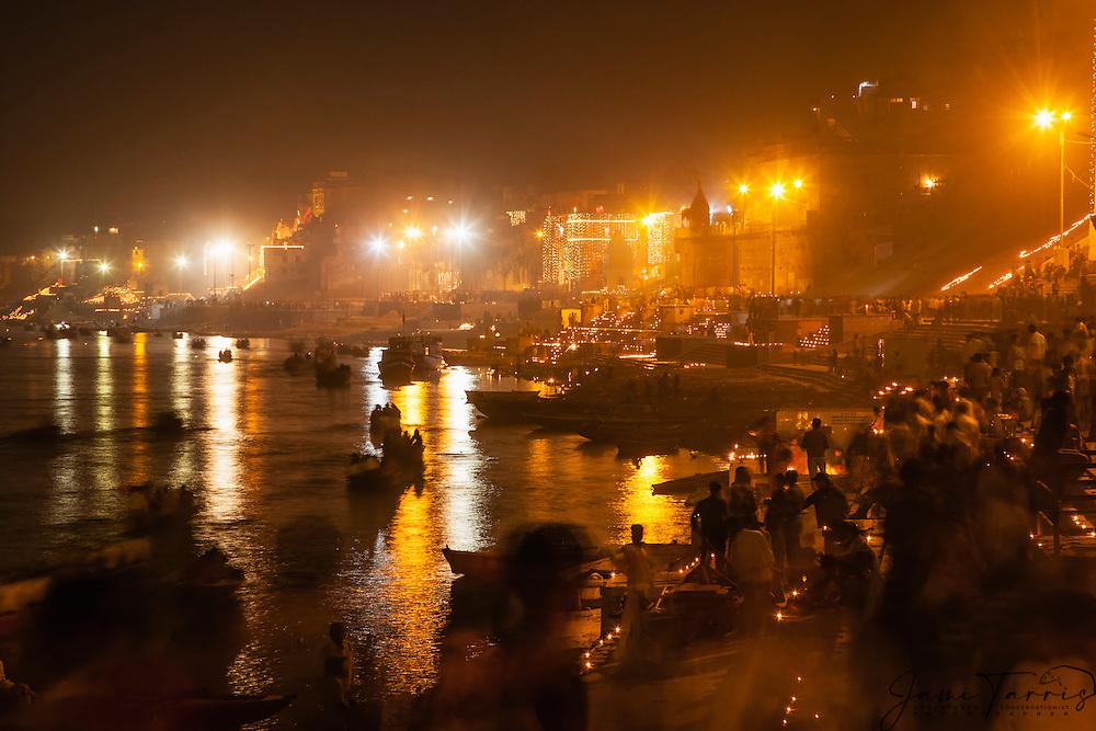 A view down the Ganges River at night from the main Dasaswamedh Ghat in Varanasi, Varanasi, Uttar Pradesh, India