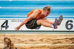 Sven Jansons in action on long jump during the Dutch Athletics Championships on 13 February 2021 in Apeldoorn