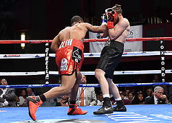 May 5, 2018 - Mashantucket, CT, U.S. - MASHANTUCKET, CT - MAY 05: Mykquan Williams  (red tape)  battles Orlando Felix  (blue tape) during their WBC USNBC Silver Lightweight Championship bout on May 5, 2018 at the Foxwoods Fox Theater in Mashantucket, Connecticut. Mykquan Williams defeated Orlando Felix via TKO of round 1. (Photo by Williams Paul/Icon Sportswire) (Credit Image: © Williams Paul/Icon SMI via ZUMA Press)