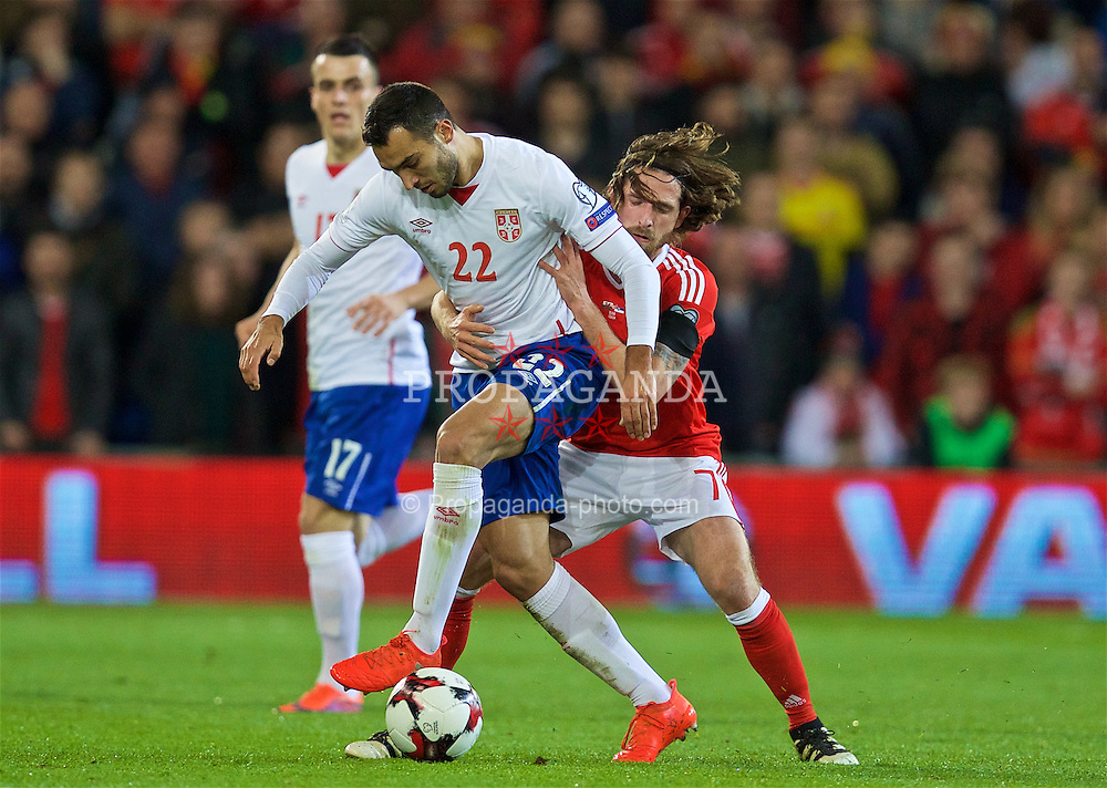 CARDIFF, WALES - Saturday, November 12, 2016: Wales' Joe Allen in action against Serbia's Ivan Obradović during the 2018 FIFA World Cup Qualifying Group D match at the Cardiff City Stadium. (Pic by David Rawcliffe/Propaganda)