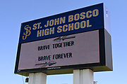 The St. John Bosco High School marquee sign amid the global coronavirus COVID-19 pandemic, Saturday, June 27, 2020, in Bellflower, Calif. The  36-acre campus is the largest private school campus in California.