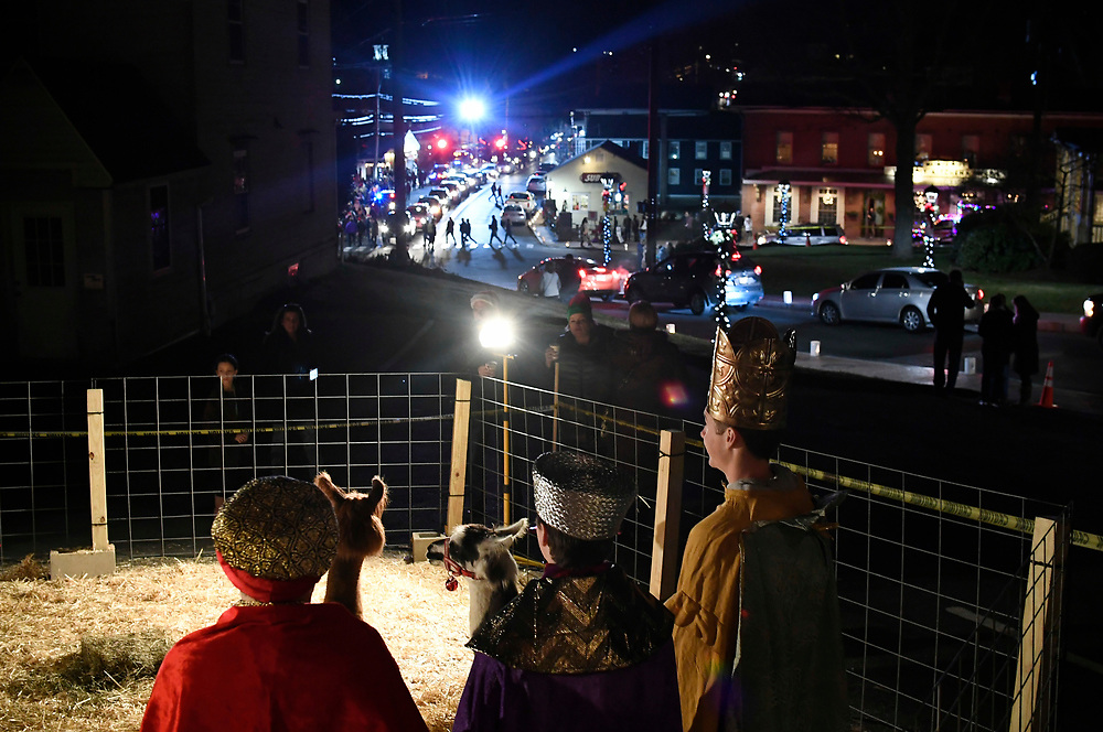Members of Faith at Newtown offer a live presentation of the meaning behind Christmas in a live nativity as residents attend a holiday festival and tree lighting in the Sandy Hook section of Newtown, Saturday, Dec. 2, 2017. (Jessica Hill for the New York Times)