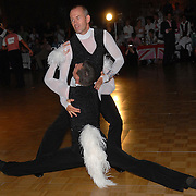 Rainer Dietzel, top, and Thomas Bensch, both of Germany, compete in the same-sex ballroom dancing competition during the 2007 Eurogames at the Waagnatie hangar in Antwerp, Belgium on July 13, 2007. ..Over 3,000 LGBT athletes competed in 11 sports, including same-sex dance, during the 11th annual European gay sporting event. Same-sex ballroom is a growing sports that has been happening in Europe for over two decades.