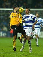 Photo. Chris Ratcliffe<br /> QPR v Rushden & Diamonds. Nationwide Division 2. 03/01/2004<br /> Andy Sambrook of Rushden and kevin McLeod of QPR tussle for the ball.