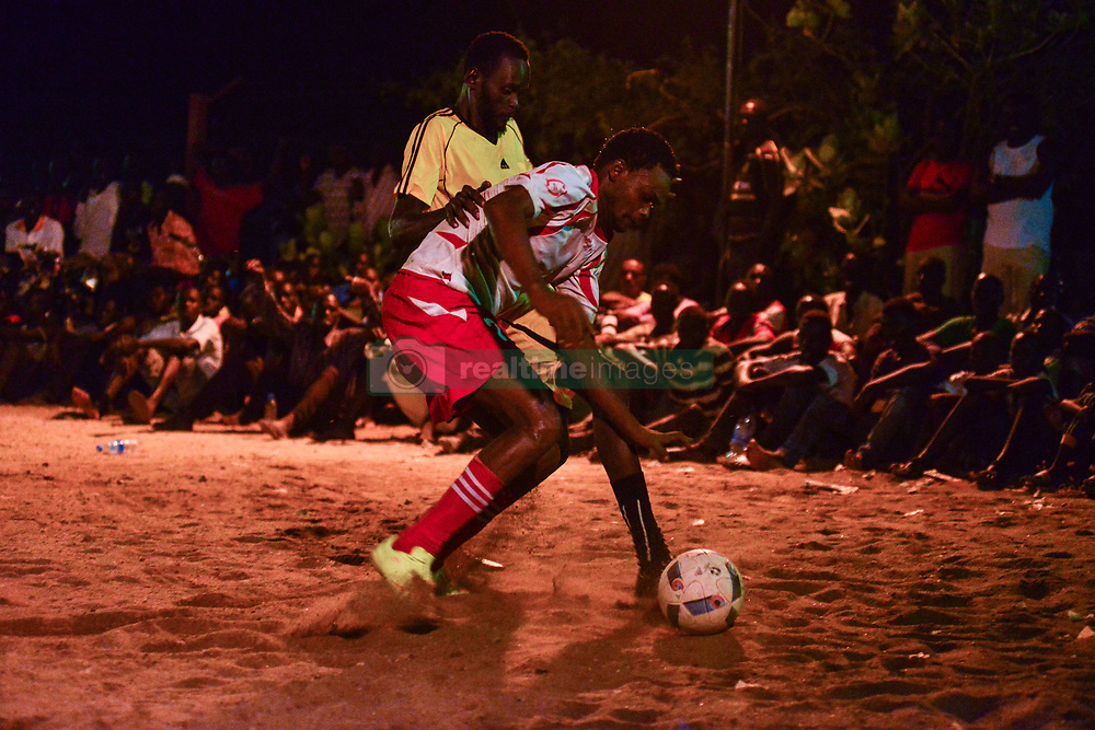 June 23, 2017 - Juba, Central Equatorial, South Sudan - A player with Team Commando fights for the ball against Team Airport in the finals of the ''Ramadan League'' in the South Sudanese capital of Juba Friday, as the Muslim Holy month of Ramadan comes to a close in the African nation ravaged by civil war. The UN estimates that two-thirds of the nation is facing the threat of famine. (Credit Image: © Miguel Juarez Lugo via ZUMA Wire)
