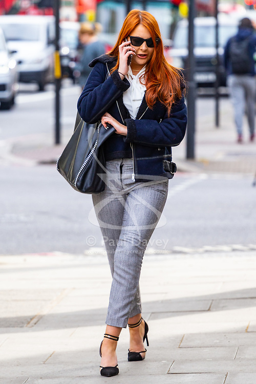 Siobhan Tedder, 26, a Playboy Bunny, arrives at Westminster Magistrates Court for sentencing after biting a police officer's forearm following a drunken brawl outside her Hammersmith home. PLACE, April 23 2019.
