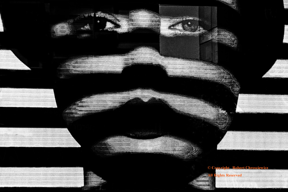 Digitally Discrete: An all too common example of sexual repression is found in this digital representation of an alluring woman's' face, dissected horizontally with slashes of black, Bangkok Thailand.