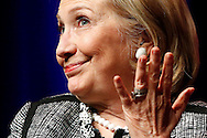 """Former U.S. Secretary of State Hillary Clinton reacts to a question as she discusses her new book """"Hard Choices: A Memoir"""" at George Washington University on a book tour widely seen as a prelude to another run for the White House."""