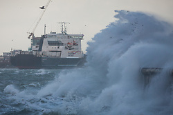 © Licensed to London News Pictures. 23/02/2017. Portsmouth, UK.  The Channel Island Ferry Commmodore Goodwill sails into Portsmouth Harbour as strong winds and large waves batter the seafront of Southsea Promenade this morning, 23rd February 2017, as Storm Doris hits Britain. Photo credit: Rob Arnold/LNP