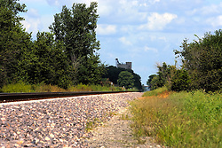 27 August 2011: High Dynamic Range image (HDR) of Railraod tracks, used today by Amtrak, head north from Funks Grove and past nearby Shirley Illinois as they parallel old historic Route 66 in McLean County.