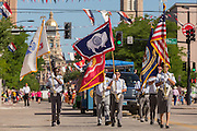 Military veterans marching in the Cheyenne Frontier Days parade past the state capital building July 23, 2015 in Cheyenne, Wyoming. Frontier Days celebrates the cowboy traditions of the west with a rodeo, parade and fair.