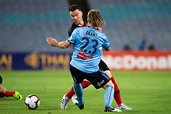 December 15, 2018 - Sydney, NSW, U.S. - SYDNEY, NSW - DECEMBER 15: Sydney FC defender Rhyan Grant (23) and Western Sydney Wanderers midfielder Alexander Baumjohann (10) battle for the ball at the Hyundai A-League Round 8 soccer match between Western Sydney Wanderers FC and Sydney FC at ANZ Stadium in NSW, Australia on December 15, 2018. (Photo by Speed Media/Icon Sportswire) (Credit Image: © Speed Media/Icon SMI via ZUMA Press)