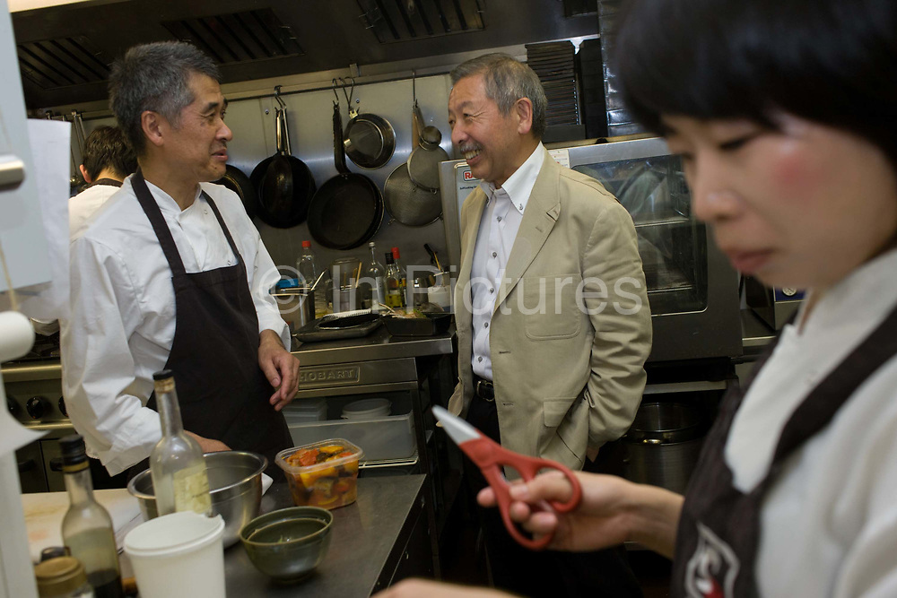 Japanese entrepreneur, Tetsuro Hama with sushi chef and old friend, Kaoru Yamamoto at his 'So' restaurant business, Soho, London. Hama is the owner of So plus a north London car dealership. He arrived from Japan in 1973, looking for business opportunities before starting a hotel in a Bayswater backstreet. He then went into the restaurant industry, soon earning the respect of employees and customers for affordable and tasty sushi. <br /> From the chapter entitled 'The Price of Happiness' and from the book 'Risk Wise: Nine Everyday Adventures' by Polly Morland (Allianz, The School of Life, Profile Books, 2014).