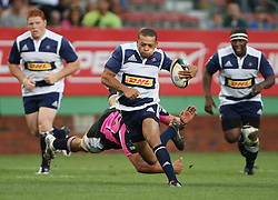 Elgar Watts of the DHL Stormers breaks through the defensive line during the final warm-up match before the start of the Super Rugby season between the DHL Stormers and the Boland Cavaliers held at DHL Newlands Stadium in Cape Town, South Africa on 12 February 2011. Photo by Jacques Rossouw/SPORTZPICS