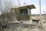 Chernobyl, Exclusion Zone, Ukraine. Overgrown bus shelter, taken over  by  nature. The  Chernobyl Reactor, town, plant and environs just before the 20th anniversary of the nuclear disaster.