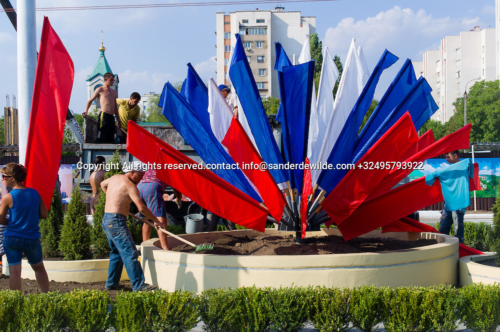20150831 Moldova, Transnistria,Pridnestrovian Moldavian Republic (PMR) Tiraspol. Rehersal for the big parade, in the 25th  Transnistrian independance day when  they had a war separating from Moldova.Only two days before the celebrations. Workers are still busy putting russian flags in newly made cental lane.