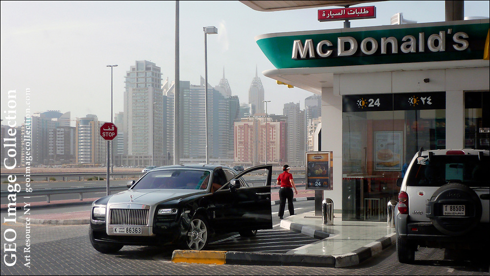 A massive Rolls Royce Ghost, which sells for more than $300,000 U.S. dollars new, stops at a drive-through McDonalds restaurant in Dubai in the United Arab Emirates.