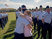 New Airman Nicholas Rogers, 19, gets a hug from his girlfriend Clare Shoemaker, 18, after taking his oath of service at Joint Base San Antonio-Lackland during the Fiesta Military Parade and basic training graduation in San Antonio, Texas on Friday, April 19, 2019. Rogers and Shoemaker are from Mountain Grove, Missouri.