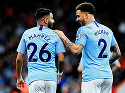 Manchester City's Kyle Walker celebrates with Riyhad Mahrez, after Mahrez scores his sides first goal of the match during the Premier League match at The Vitality Stadium, Bournemouth.
