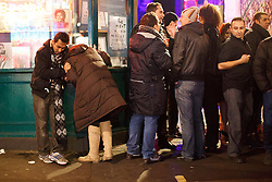"© licensed to London News Pictures. London, UK 14/12/2013. ""Mad Friday"" revellers in Soho, London enjoy the last Friday night out before Christmas, which is also the busiest night of the year for emergency services. Photo credit: Tolga Akmen/LNP"